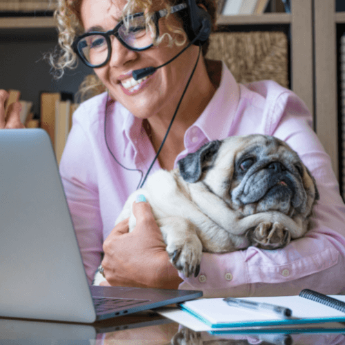 Woman and her dog working on a computer
