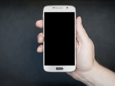 Picture of a hand and cell phone